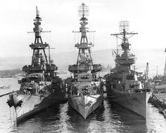 USS Salt Lake City (CA-25), USS Pensacola (CA-24) and USS New Orleans (CA-32) (listed from left to right) nested together at Pearl Harbor, 31 October 1943, after completion of repairs. The USS New Orleans had her bow ripped off from the second turret forward in the Battle of Tassafaronga. Note radar antennas, gun directors and eight-inch guns on these three heavy cruisers.