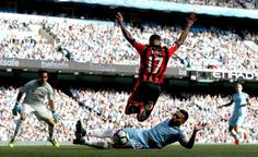 Nicolas Otamendi and Joshua King battle for the ball