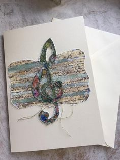A Fiddlestitched Treble Clef Card...... A print is taken from my original mixed media design and stitched into with silk threads. Each stitched piece is then ripped by hand and mounted on to a gift card. Keepsake Cards to be framed not recycled! All Cards may vary slightly due to each being Music Jewelry, Treble Clef, Music Gifts, Silk Thread, Music Lovers, Card Sizes, I Card, Teacher Gifts, Shoulder Bag