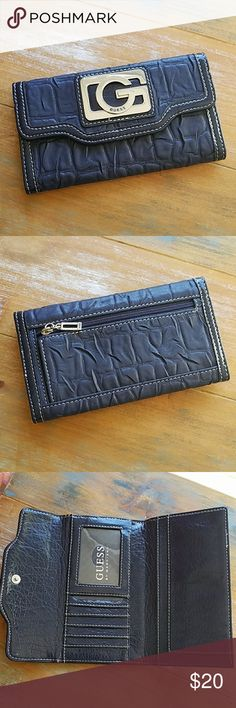 """Guess by Marciano Navy Blue Tri Fold Wallet Looks new, really cute tri fold Guess wallet in navy blue, silver hardware and shiny patent look inside, in like new shape, measures 6.25"""" long, 3.5"""" high and .5"""" deep.  Happy to answer questions, thanks! 🌼🌼🌼 Guess by Marciano Bags Wallets"""