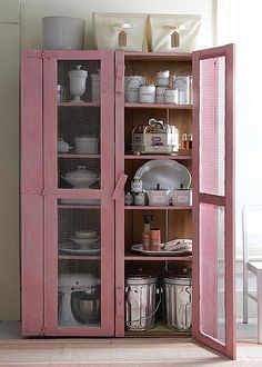Shabby Modern Country Urban Farmhouse Pantry Envy by theunquietlibrarian, via Flickr.   Not crazy about the color, but good idea for cabinet