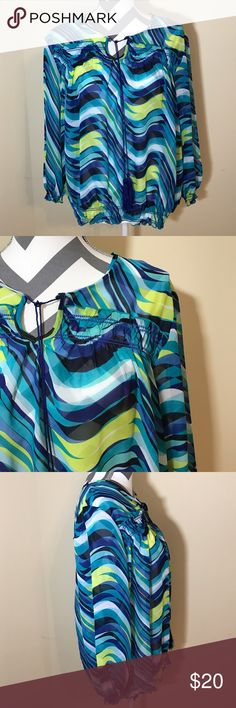 "🌺SALE! New Direction Blue Green Wave Peasant Top Excellent Pre-loved Condition, Like New! Women's Blue Green Wave Print Peasant Blouse by New Directions  Size: XL, 25"" long, 23.5"" across bust, 19.5"" long sleeves laying down flat Material: 100% Polyester Description: Pullover, sheer, tassels with keyhole in the front, elastic waist and arm bands, flowwy new directions Tops Blouses"
