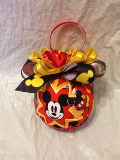 Order of 10 ornaments  Made with Mickey Mouse fabric, this ornament is accented with yelliw fabric. It is topped with red, yellow and Mickey print ribbon. Great for the Mickey fan!  Do you yearn to be at Disney World or Disneyland ALL THE TIME!!! This little bit of Mickey can help ease the pain of work and not being with your favorite mouse!!  PIN MY LISTINGS TO SAVE  To get a 10% discount on any order, just follow these steps:  1) Pin 3 of my listings to your Pinterest account 2) Click on…
