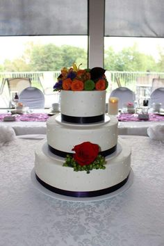 A simple design accented with fresh flowers. www.mitchels.ca #wedding #weddingcakes #simple #flowers