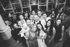 Wedding guests pose for a photo at Oceanblue/Westhampton Bath & Tennis in Westhampton, NY. Captured by NYC wedding photographer Ben Lau.