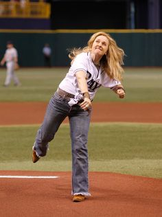 Melissa Etheridge threw out the first pitch at the Rays game at the Trop. Check out this great photo by Rays photographer Skip Milos.