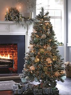 Fill your home with festive joy with a sparkly Christmas tree, gold and silver traditional decorations.