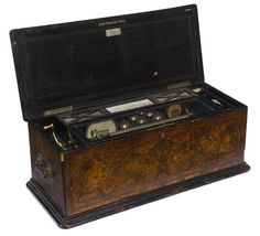 A Swiss inlaid walnut orchestral interchangeable cylinder music box A. Rivenc & Co., Geneva late 19th century