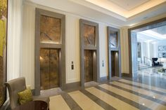 love these burnished metal doors Corinthia Hotel London | Based Upon