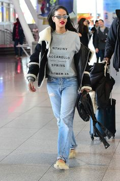 Rihanna wears a pair of fuzzy slippers from designer Simone Rocha as she walks through JFK airport in New York City on March 11, 2015.   - Cosmopolitan.com