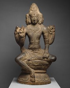 Shiva as Mahesha. Chola period (880–1279),10th century.India (Tamil Nadu). This statue is part of a group of unusual large stone carvings in the round from the Chola period. They all portray the same deity, long identified as Brahma but now thought to be Mahesha, a form of Shiva. From him are born the other two great Hindu gods, Brahma and Vishnu. Mahesha is shown with four faces: the one on the right represents Brahma; in the center, Shiva; on the left, Vishnu; and on the back, Rudra .