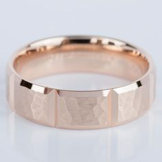 Check out the stunning detail in this Hammered Carved Men's Wedding Ring in Rose Gold!