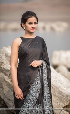 PRICE INR 9,498/-; US$ 143.00 To buy click here https://www.eastandgrace.com/products/aratrika-black-silk-satin-saree Featuring the Aratrika, black pure satin embroidered saree with a thick, hand-embroidered, white, spring floral detailing along a border. The black, satin blouse has a halter neckline and charming tie-back, large bow. Your key to winning hearts with black and white. Reach us: care@eastandgrace.com