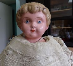 Antique German Metal Head Minerva Doll with Leather Body and old Clothes