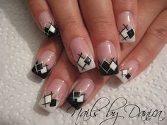 A white and black combination of gingham inspired French tips. The white and black colors are painted in inverse to reveal the striped design.