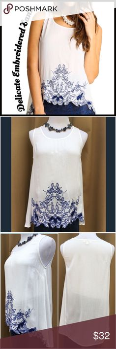Delicate Embroidered Tank Delicate Embroidered Tank; high-low style; white tank with navy embroidery. Boutique Tops