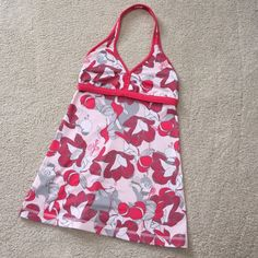 Lululemon halter tank Lululemon halter style tank. Pretty open back, with horizontal strap for support. Low v neck with stitching detail. Floral print is white, light pink, medium pink and grey. Size 4. I typically wear a 6 in Lulu tops and this fits me, but the back strap is a little tight. This style is best for a smaller chested gal, in my opinion. Gently used; very good condition. lululemon athletica Tops
