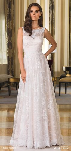 Vintage lace details on this A-line gown with a scalloped Sabrina neckline, natural waistline, and chapel length train create a demure wedding day look.