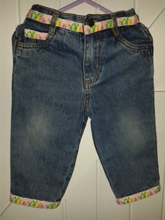 Up-dated, pre-loved, good quality denim 'Bunny hop' Jeans. Now with added 'bunny'ribbon interest to all pockets and hems.  9-12 months      £7.50 See https://folksy.com/shops/sldelaney