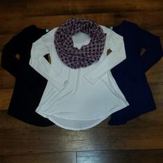 We absolutely LOVE these new comfy tops available in black, navy and white! Pair them with a fun scarf or jewelry! #apricotlaneomaha #apricotlaneboutique #tops #comfyclothes #longsleeves #lovefashion #gottahaveit