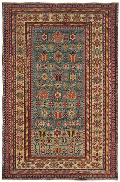 """DAGHESTAN, Northeast Caucasian 4ft 2in x 6ft 4in Circa 1875 Representing our expansive, world-class collection of much-loved antique Caucasian tribal rugs, this clearly drawn piece is distinguished by a with a quixotic color shift in its radiant cerulean blue field. Several crisply drawn borders serve as an elaborate """"window frame"""". Age-old symbols floating within this three dimensional plane exemplify the alluring artistry of this tribal weaving tradition."""