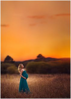 Gorgeous pregnant woman has her maternity photos taken in a golden field at sunset near las vegas nv