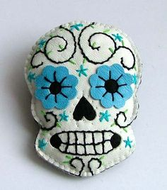 sugar skull. Would be cute as a throw pillow