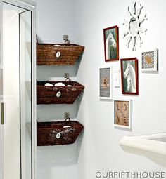 A good use of a small space for bathroom storage using flower baskets.  Love the framing arrangement, too.