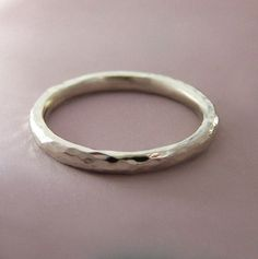 A simple ring. I kind of like the idea of no stone even for engagement. Otherwise this would be a great wedding band.