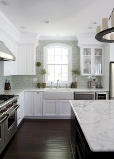 white cabinets and grey subway tile.