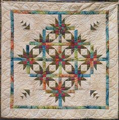 Love love LOVE this.  Upon close inspection, these blocks have cathedral corners & could EASILY be done with 10-minute block treatment.  Just beautiful!  So many smart quilters out there!  Adel Quilting & Dry Goods Co.