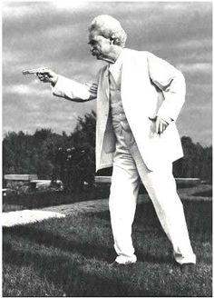 Clemens poses with a pistol  shortly after a burglary at his home in   Redding, CT., 1908