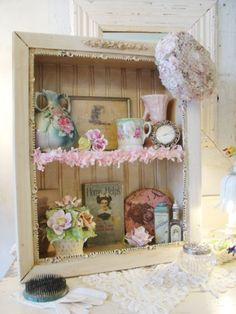 Sort of like a shadow box with the glass...good way to use an old cabinet that has no door... put beadboard in the back... love it