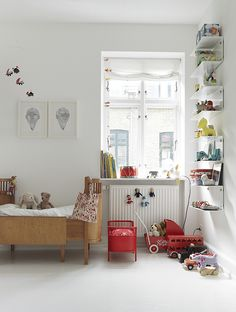 Even the children's rooms, though peppered with colorful details, retain the stark white walls and minimal feel of the rest of the Egelunds' home. The wooden bed is by Juno, the doll bed are by Flos Lampadina, and the shelves are Vipp. Courtesy of Vipp. Baby Bedroom, Kids Bedroom, Kids Rooms, Scandi Bedroom, White Bedroom, Nursery Room, Bedroom Ideas, Master Bedroom, Casa Kids