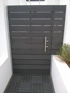 Side gate ideas, love the planter to block my neighbors crap! 4 Everdeck Charcoal Grey Decking Boards used for cladding gate and DIY decking tiles.