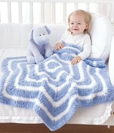 Follow this free crochet pattern to create a star baby blanket using Bernat Pipsqueak chunky weight yarn.