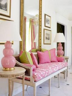 Glamorous living - Pink and green sofa and mirror.jpg