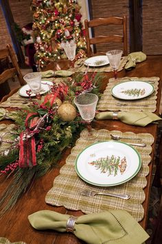 Breakfast table dressed for the holidays with a festive centerpiece and holiday dinnerware.