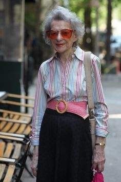 """ADVANCED STYLE: """"I am a sucker for any pair of color tinted eyeglasses  and I especially love how this woman matches her lipstick to her orange frames."""" Agree!"""