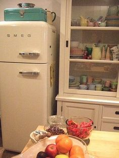 Totally wish I could have a SMEG fridge. I would get red. I just wish they were slightly bigger.