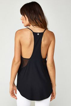 561ef4bd1efaee Lightweight workout tank with open mesh to show off your sports bra. Skinny  racerback design