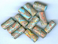 Porcelain High Fired Tube Beads - Handmade in USA - Retro Swirls of Turquoise, Coral, Yellow and Orange.