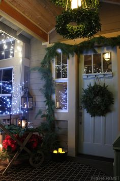 A DIY boxwood wreath chandelier is a festive way to bring Christmas to your front porch! Click here for more decor ideas.