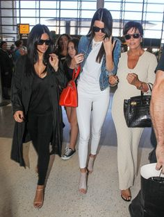 Reality stars Kris Jenner, Kim Kardashian, and Kendall Jenner are seen departing on a flight at LAX airport in Los Angeles, California on July 31, 2014. Kris recently called out her daughter Kim for taking to many 'selfies' while on a family trip to Thailand.
