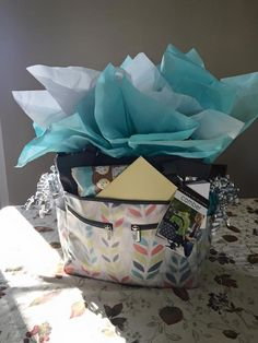 $100 baby shower gift. Made 4 in past 3 years.  JJ Cole diaper bag (style Mode or Camber) - Filled with Carter's onesies, wipes, munchkin diaper bags, diaper cream, hand sanitizer, small toy, baby book, bottle carrier, cups, spoons, small food storage containers.