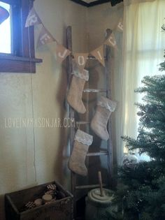 rustic christmas decor - burlap and lace stockings. cute way to hang stocking if you don't have a fireplace