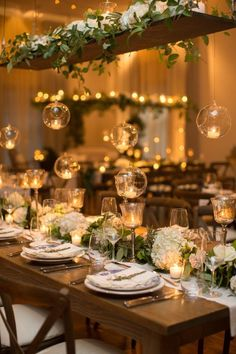 hanging votives wedding reception decor  / http://www.himisspuff.com/hanging-glass-globes-wedding-decor-ideas/4/
