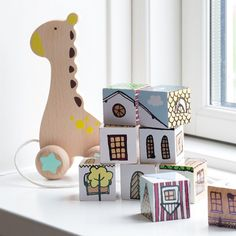 """""""Sturdy, wooden toys for the little ones,"""" Anna says. In shops now. Toy bricks, price per pack of nine DKK 34,40 / SEK 47,70 / SEK 49,90 / EUR 8,84 / ISK 944 / GBP 4.26"""