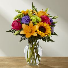 Best Day Bouquet B07 Best Day Bouquet is ready to create a moment your recipient will always remember! An instant mood booster with it's mix of bright bold colors, this gorgeous fresh flower arrangement brings together sunflowers, hot pink roses, purple double lisianthus, orange LA Hybrid Lilies, yellow snapdragons, green button poms, and lush greens to make this day, their best day. Presented in a clear glass vase. 54.99 www.tiltedtulipflorist.com