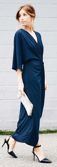 Long Sexy Navy Night-Out Maxi Dress One Can Pair With White Clutch And Black High Heels.